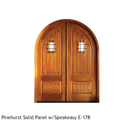Round top French Country style Mahogany double front entry doors, iron grill speakeasy, iron clavos, V-grooved wood panels, clear glass