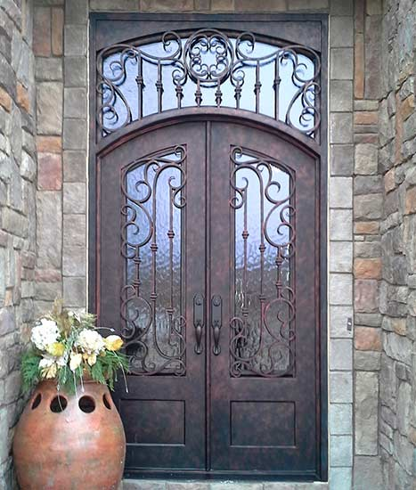 Arched double iron entry doors w/ transom, French Country style, stock Chateau Collection, Patented Thermal Break, antique copper finish, Flemish glass