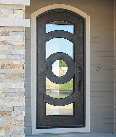 Custom Iron single arched door entry, Patented Thermal Break, contemporary style, hand-rubbed bronze finish, clear glass