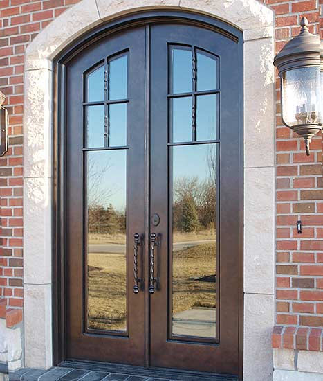 Country Farmhouse style arched double door front entry, stock Tuscan Collection, Patented Thermal Break, Copper Patina, clear glass