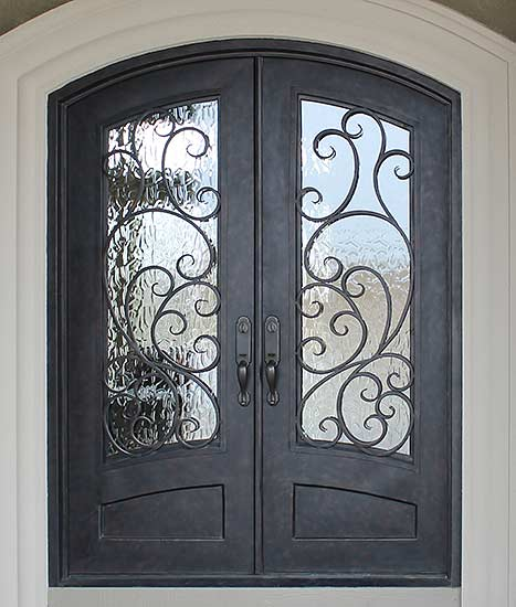 Double iron door arched top front entry, Spanish style, Santa Cruz stock Collection, operable iron grill, Patented Thermal Break, hand-rubbed bronze finish