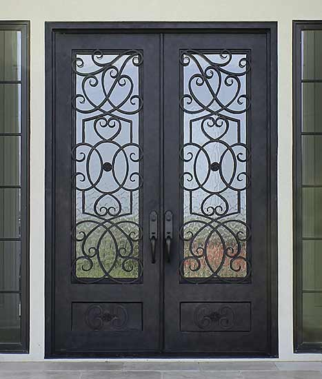 Custom double iron exterior entry, Mediterranean style, Flemish glass, Patented Thermal Break, hand-rubbed bronze finish