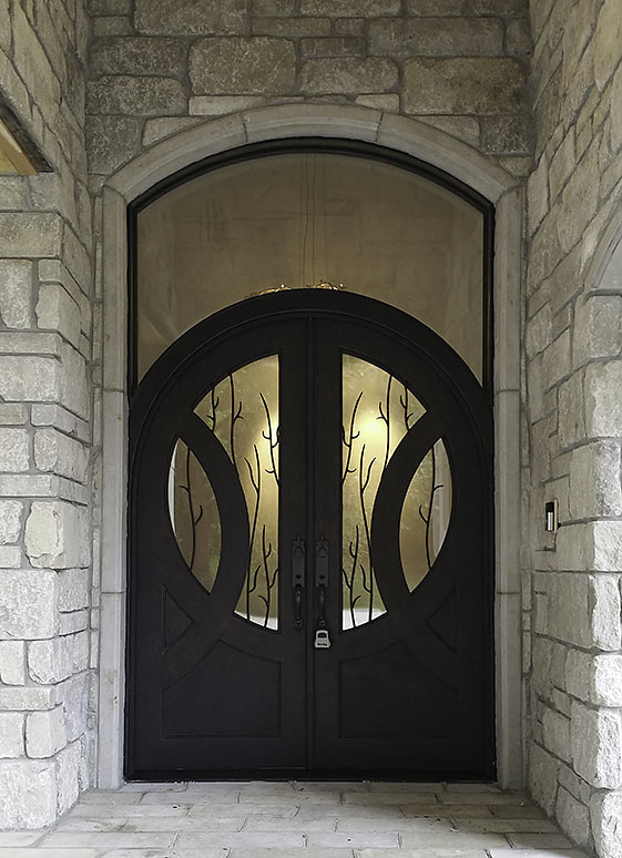 Custom Iron door double entry, contemporary style, arched top w/ transom, tree branch grill, Black finish, circle glass panel, clear glass, Patented Thermal Break